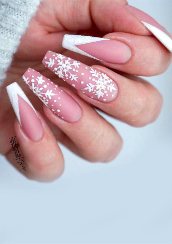Long nude French tip nails with snowflake nail art