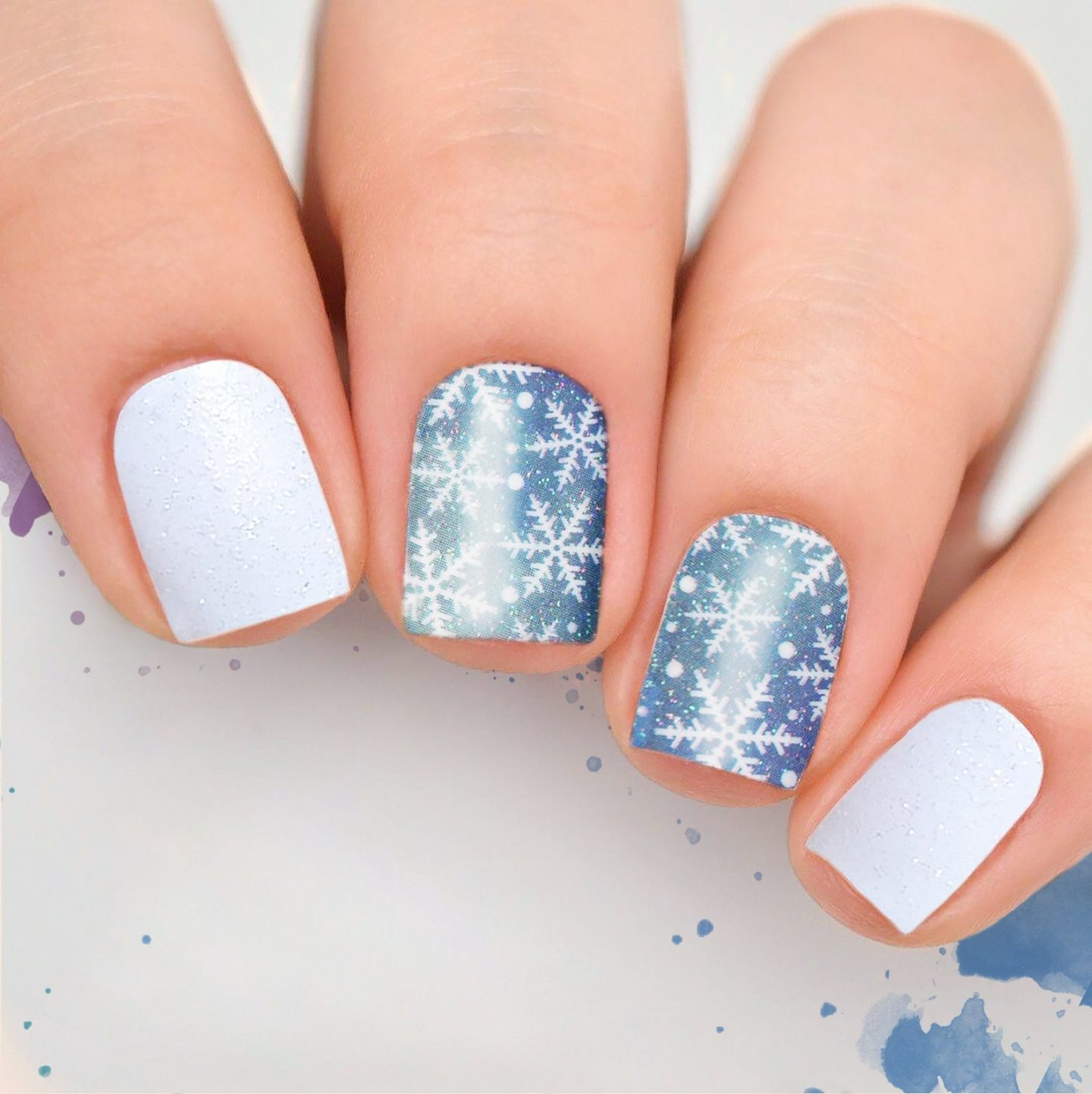 Cute short white and light blue snowflake nails