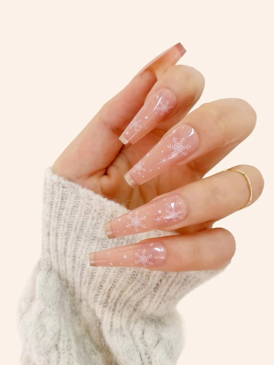Long nude coffin nails with snowflake nail art
