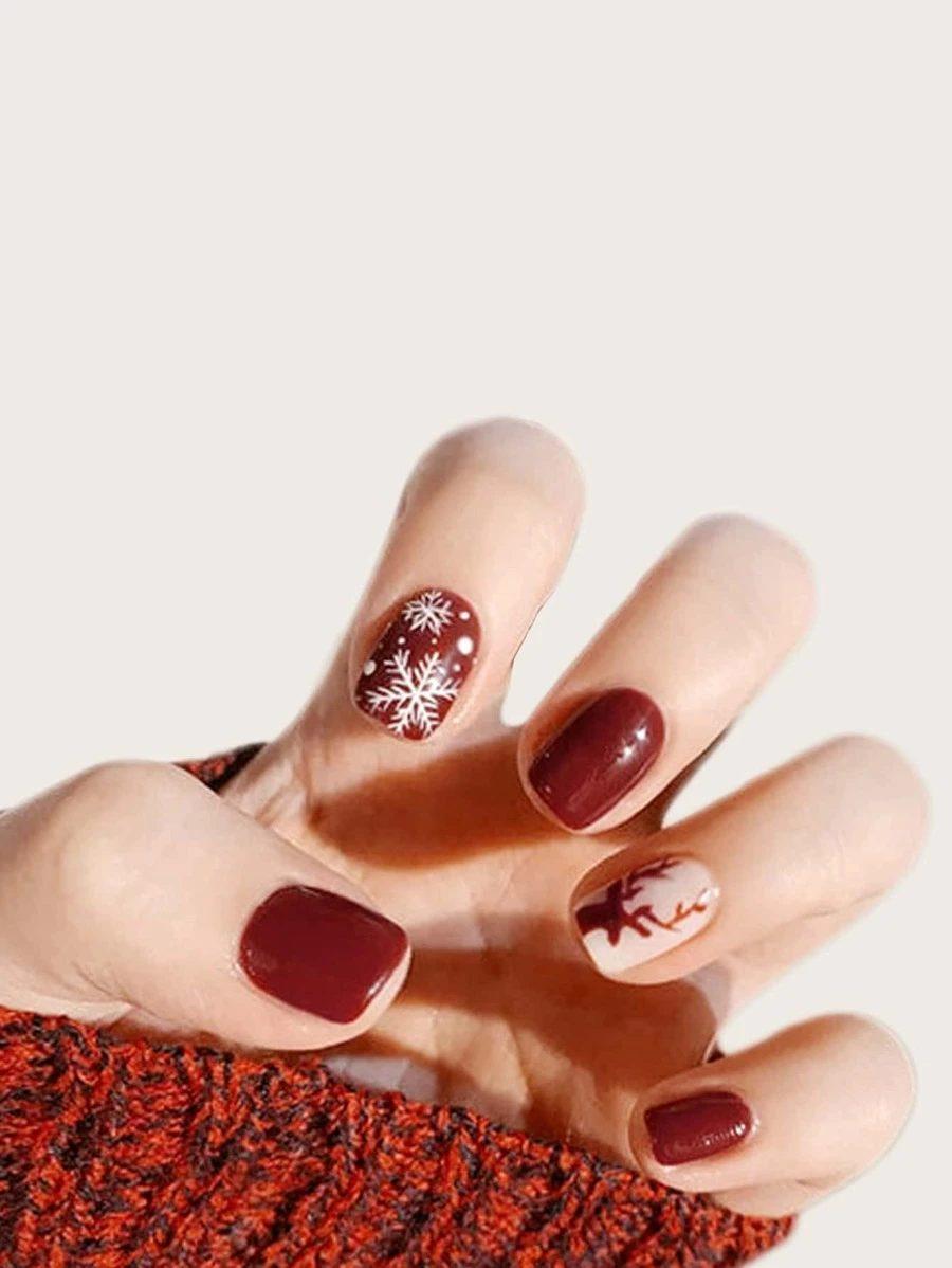 Cute short burgundy Christmas nails with snowflake nail art