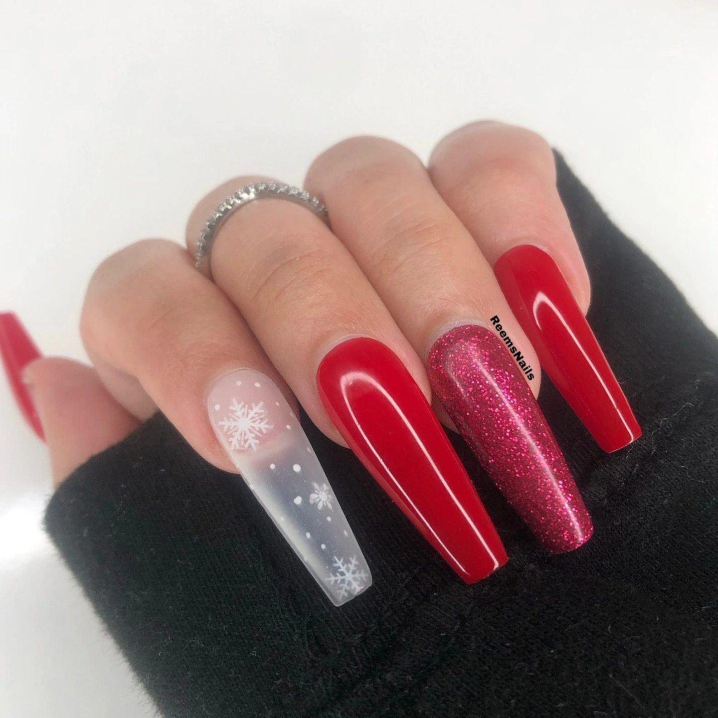 Long red coffin nails with glitter and snowflake nail art