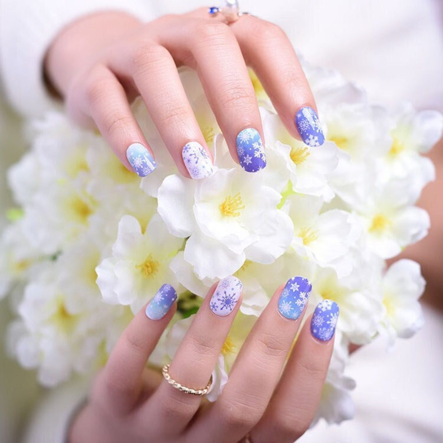 Short white and blue snowflake nails