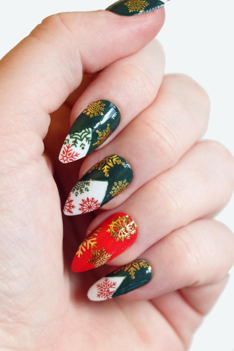 Dark green and red Christmas nails with gold snowflake nail art